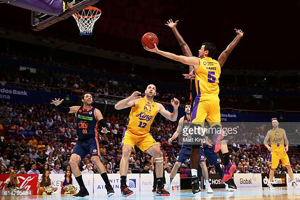 Jason Cadee of the Kings drives to the basket during the round two NBL match between the Sydney Kings and the Cairns Taipans at Qudos Bank Arena on...