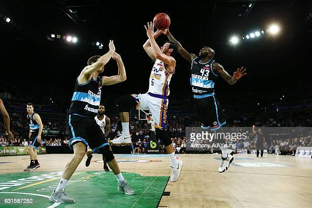 Jason Cadee of the Kings goes up against Kevin Dillard of the Breakers during the round 15 NBL match between the New Zealand Breakers and the Sydney...