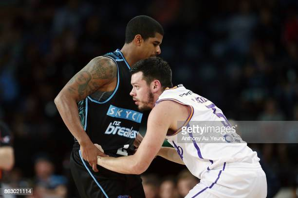 Jason Cadee of the Kings is helped up by Edgar Sosa of the Breakers during the round three NBL match between the New Zealand Breakers and the Sydney...