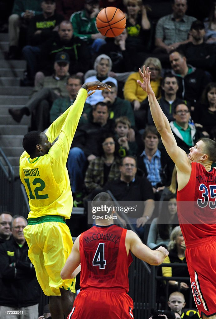 Jason Calliste #12 of the Oregon Ducks hits a big three point shot over <a gi-track='captionPersonalityLinkClicked' href=/galleries/search?phrase=Kaleb+Tarczewski&family=editorial&specificpeople=8047518 ng-click='$event.stopPropagation()'>Kaleb Tarczewski</a> #35 of the Arizona Wildcats during the second half of the game at Matthew Knight Arena on March 8, 2014 in Eugene, Oregon. Oregon won the game 64-57.