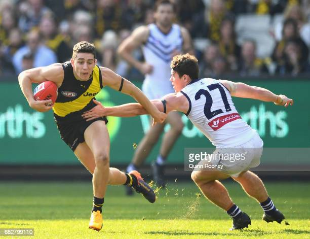 Jason Castagna of the Tigers avoids a tackle by Lachie Neale of the Dockers during the round eight AFL match between the Richmond Tigers and the...