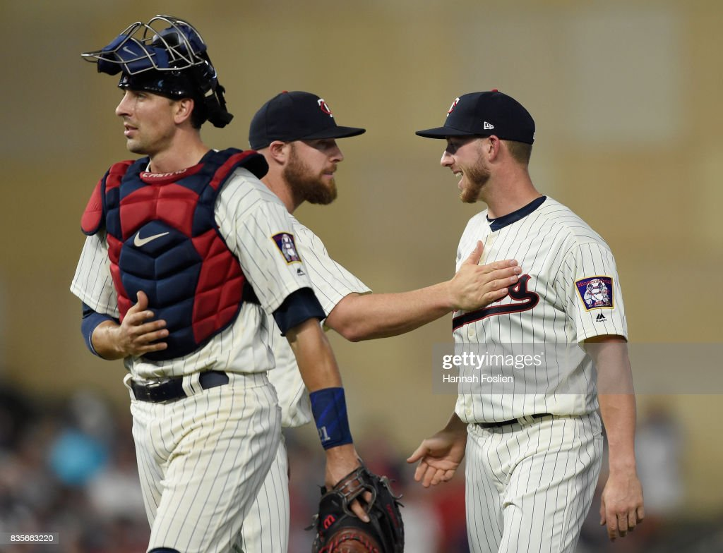 Jason Castro #21, Chris Gimenez #38 and Mitch Garver #43 of the Minnesota Twins celebrate winning against the Arizona Diamondbacks after the game on August 19, 2017 at Target Field in Minneapolis, Minnesota. It was Garver's Major League debut. The Twins defeated the Diamondbacks 5-0.