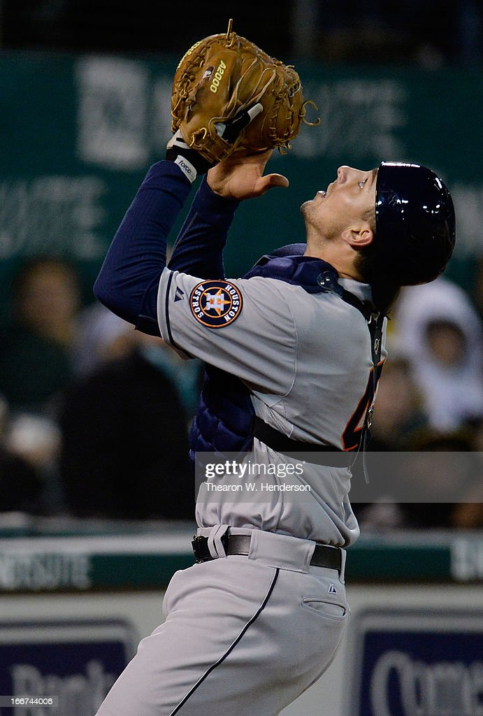 Jason Castro of the Houston Astros catches a foul pop-up against the Oakland Athletics at O.co Coliseum on April 15, 2013 in Oakland, California. All uniformed team members are wearing jersey number 42 in honor of Jackie Robinson Day.