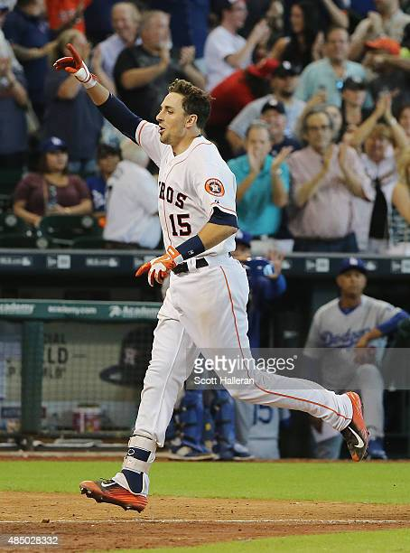 Jason Castro of the Houston Astros celebrates his solo home run in the tenth inning to defeat the Los Angeles Dodgers 32 during their game at Minute...