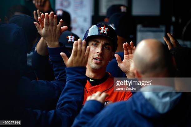 Jason Castro of the Houston Astros celebrates with his teammates in the dugout after scoring a run off of George Springer single against Johnny Cueto...