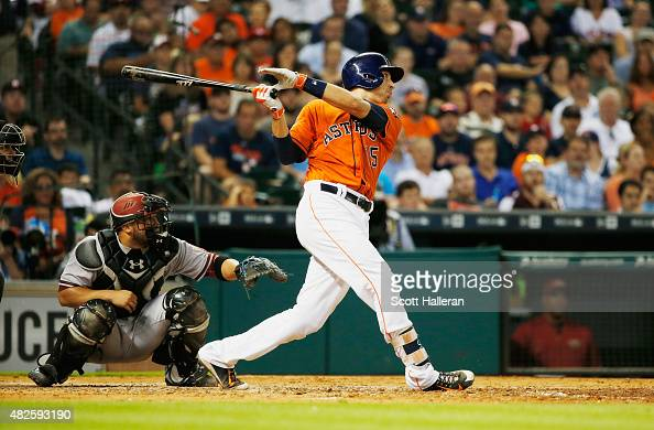 Jason Castro of the Houston Astros connects on a threerun home run in the fifth inning during their game against the Arizona Diamondbacks at Minute...