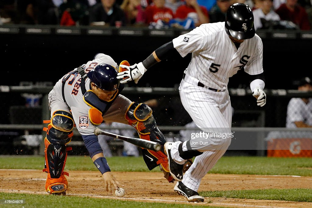 Jason Castro #15 of the Houston Astros fields the ball after a dropped third strike as Carlos Sanchez #5 of the Chicago White Sox runs to first base during the sixth inning on June 8, 2015 at U.S. Cellular Field in Chicago, Illinois.