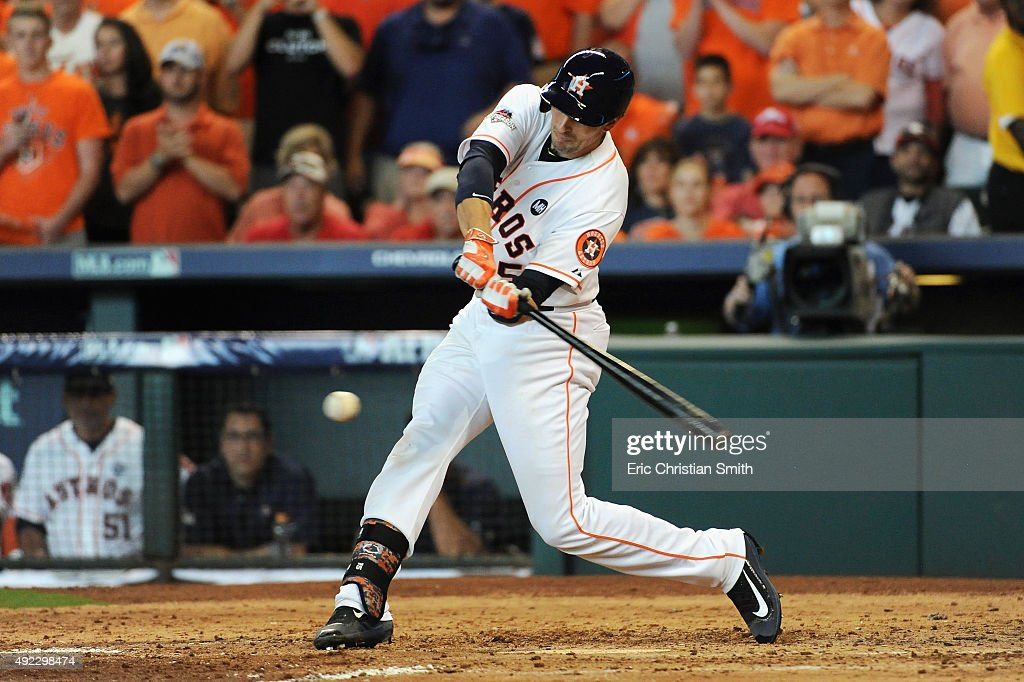 Jason Castro of the Houston Astros hits a tworun RBI single in the fifth inning against the Kansas City Royals in game three of the American League...
