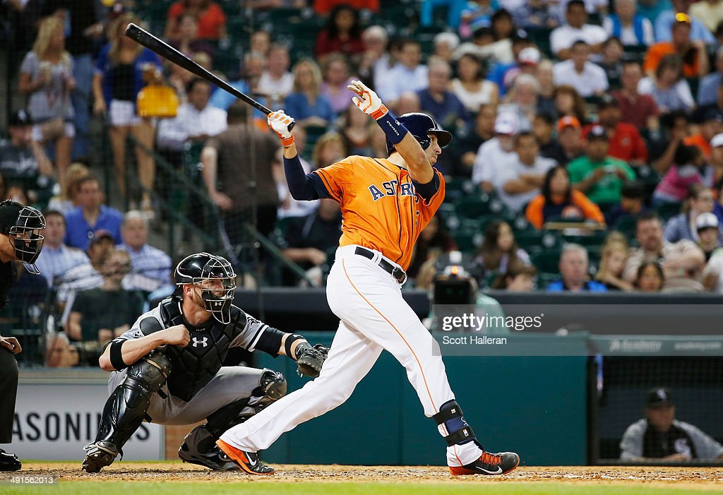 Jason Castro #15 of the Houston Astros hits an RBI single in the fifth inning of their game against the Chicago White Sox at Minute Maid Park on May 16, 2014 in Houston, Texas.