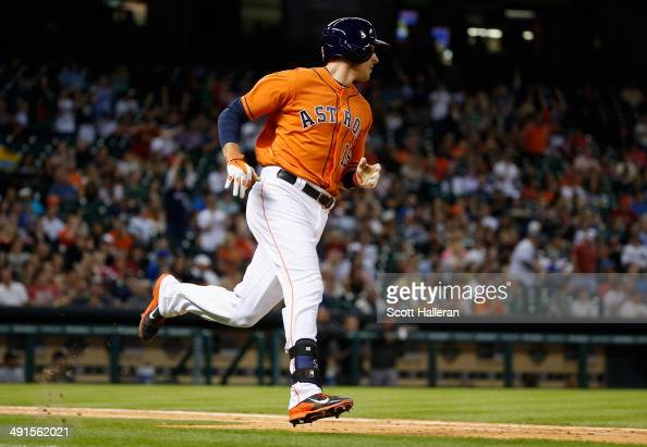 Jason Castro of the Houston Astros hits an RBI single in the fifth inning of their game against the Chicago White Sox at Minute Maid Park on May 16...