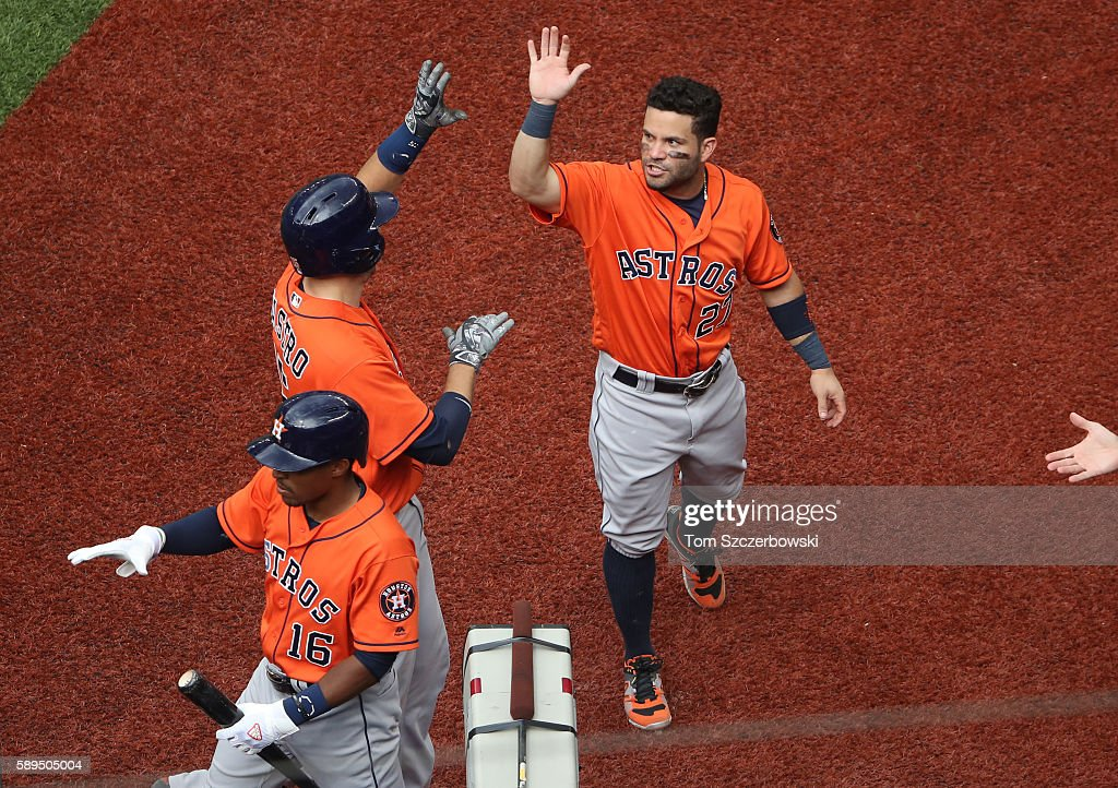 Jason Castro #15 of the Houston Astros is congratulated by Jose Altuve #27 after hitting a solo home run in the seventh inning during MLB game action against the Toronto Blue Jays on August 14, 2016 at Rogers Centre in Toronto, Ontario, Canada.