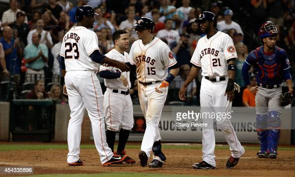 Jason Castro of the Houston Astros is congratulated by teammates folllowing a grand slam during the fifth inning of a game against the Texas Rangers...