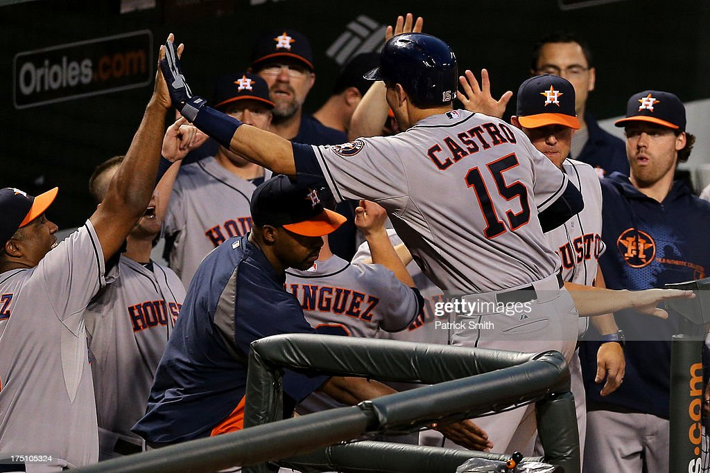 Jason Castro #15 of the Houston Astros is greeted in the dugout after hitting a grand-slam in the fourth inning against the Baltimore Orioles at Oriole Park at Camden Yards on July 31, 2013 in Baltimore, Maryland. The Houston Astros won, 11-0.