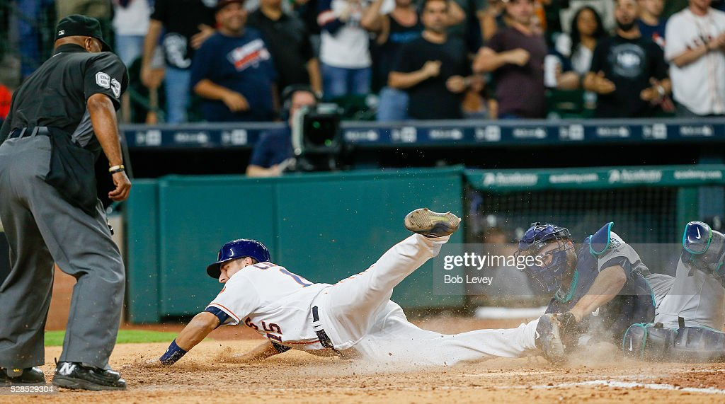 Jason Castro of the Houston Astros is tagged out at home by Chris Iannetta of the Seattle Mariners trying ton score in the seventh inning on May 05...