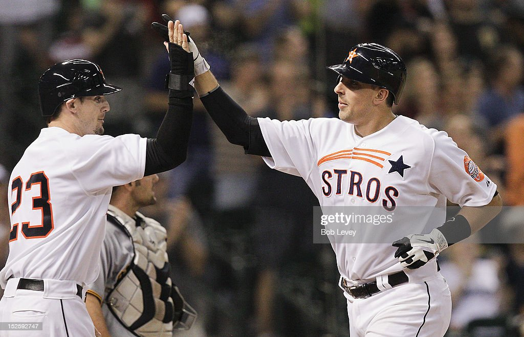 Jason Castro #15 of the Houston Astros receives congratulations from Tyler Greene #23 after hitting a three-run home run in the seventh inning against the Pittsburgh Pirates at Minute Maid Park on September 22, 2012 in Houston, Texas.