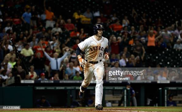 Jason Castro of the Houston Astros runs the bases following a grand slam home run during the fifth inning of a game against the Texas Rangers at...