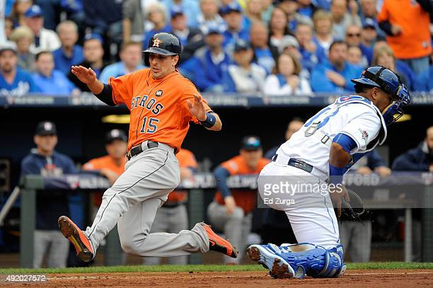 Jason Castro of the Houston Astros scores a run off of George Springer single against Johnny Cueto of the Kansas City Royals in the second inning...