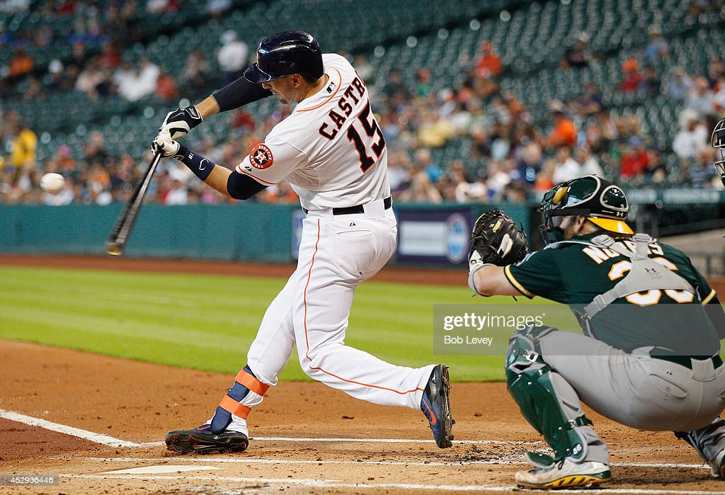 Jason Castro #15 of the Houston Astros singles in the first inning against the Oakland Athletics at Minute Maid Park on July 30, 2014 in Houston, Texas.