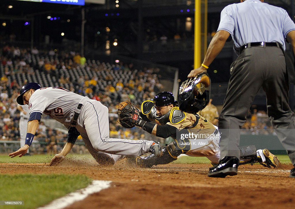 Jason Castro #15 of the Houston Astros slides in safe past <a gi-track='captionPersonalityLinkClicked' href=/galleries/search?phrase=Russell+Martin+-+Baseball+Player&family=editorial&specificpeople=13764024 ng-click='$event.stopPropagation()'>Russell Martin</a> #55 of the Pittsburgh Pirates in the eleventh inning during the game on May 18, 2013 at PNC Park in Pittsburgh, Pennsylvania.