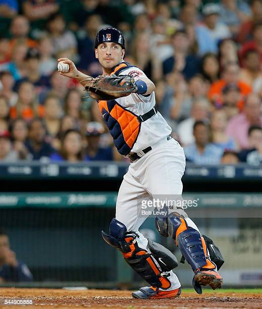 Jason Castro of the Houston Astros throws to first base to complete a double play in the seventh inning against the Seattle Mariners at Minute Maid...