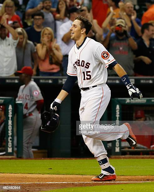Jason Castro of the Houston Astros trots home after hitting a threerun home run in the ninth inning off Fernando Salas to end the game and defeat the...