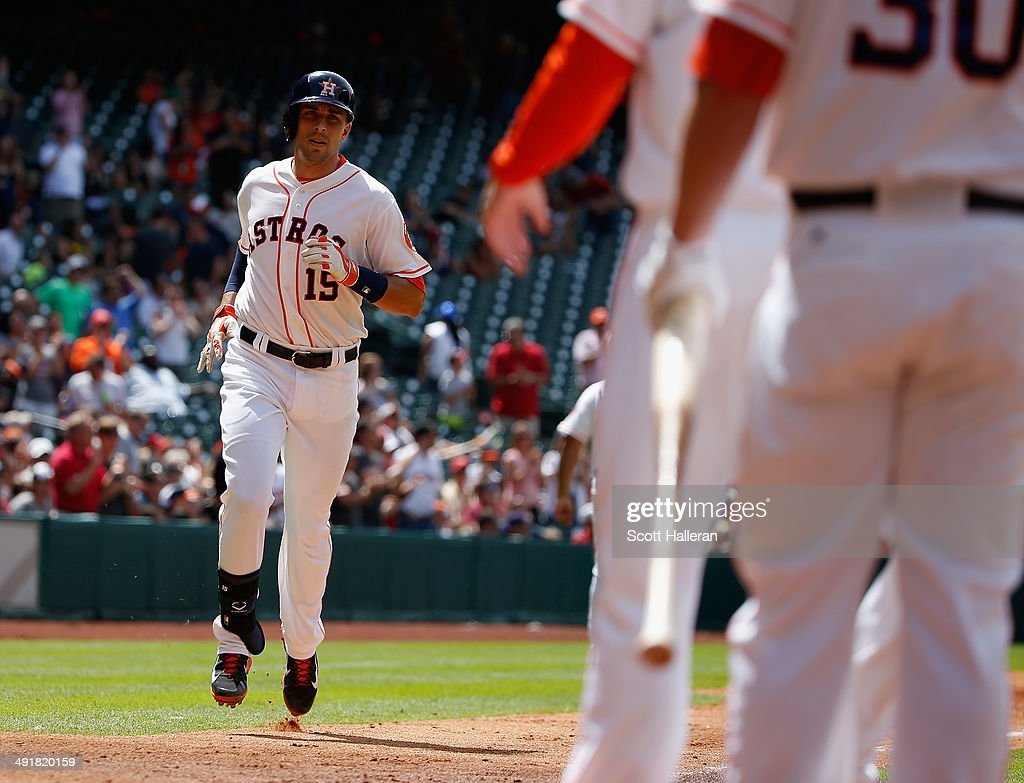 Jason Castro #15 of the Houston Astros trots home after hitting a three-run home run in the first inning of their game against the Chicago White Sox at Minute Maid Park on May 17, 2014 in Houston, Texas.