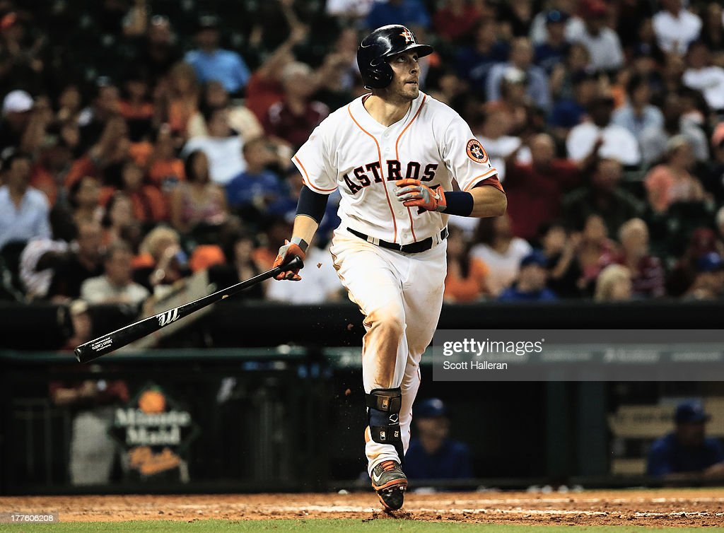 Jason Castro #15 of the Houston Astros watches his home run to right field in the seventh inning at against the Toronto Blue Jays at Minute Maid Park on August 24, 2013 in Houston, Texas.