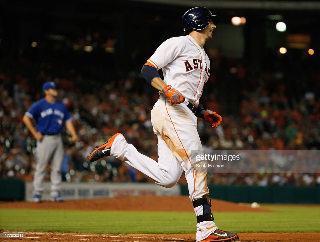 Jason Castro #15 of the Houston Astros watches his home run to right field in the seventh inning off Chad Jenkins #64 of the Toronto Blue Jays at Minute Maid Park on August 24, 2013 in Houston, Texas.