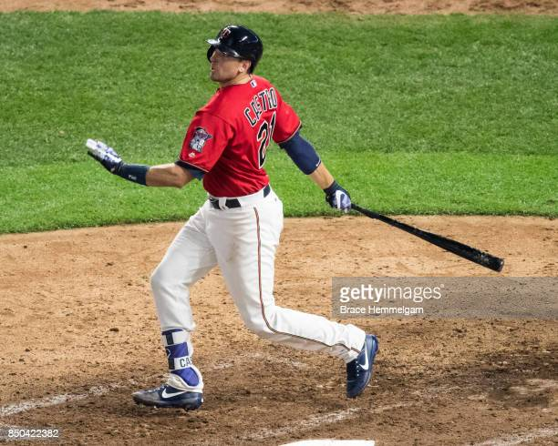 Jason Castro of the Minnesota Twins bats and hits a home run against the San Diego Padres on September 12 2017 at Target Field in Minneapolis...