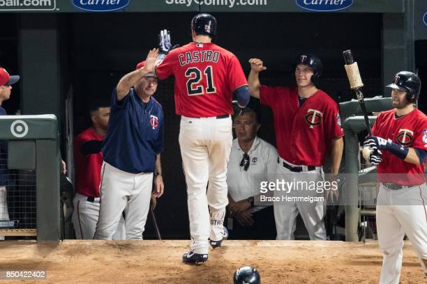 Jason Castro of the Minnesota Twins celebrates his home run with Paul Molitor against the San Diego Padres on September 12 2017 at Target Field in...