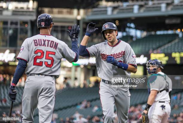 Jason Castro of the Minnesota Twins is greeted by Byron Buxton of the Minnesota Twins after Castro hit a solo home run off of starting pitcher...