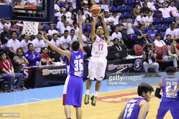 Jason Castro of the Philippines tries to shoot the ball while being contested by Patiphan Klahan of Thailand Philippines drubs Thailand 10853 during...