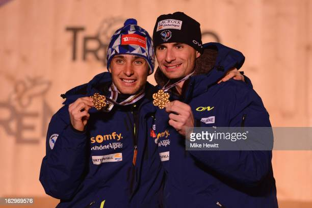 Jason Chappuis Lamy and Sebastien Lacroix of France celebrate with their Gold medals at the medal ceremony for the Men's Nordic Combined Team Sprint...