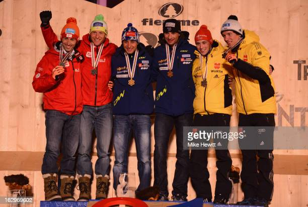 Jason Chappuis Lamy and Sebastien Lacroix of France celebrate with their Gold medals Wilhelm Denifl and Bernhard Gruber of Austria their Silver...