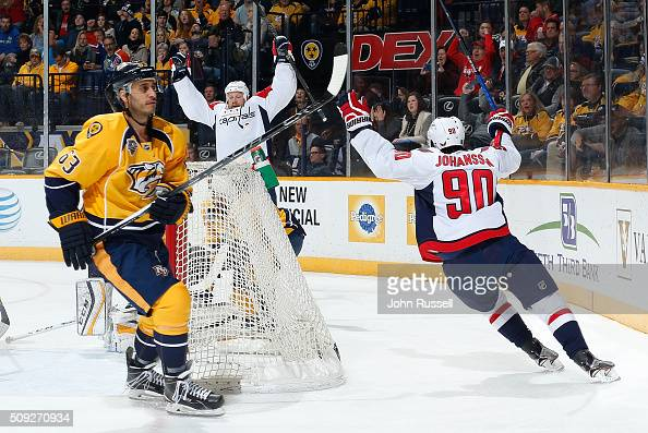 Jason Chimera and Marcus Johansson of the Washington Capitals celebrate a goal against Mike Ribeiro of the Nashville Predators during an NHL game at...