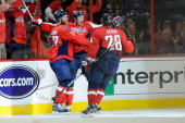 Jason Chimera celebrates with Alexander Semin and Karl Alzner of the Washington Capitals after scoring a goal against the New York Rangers in the...