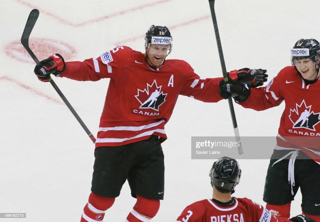 <a gi-track='captionPersonalityLinkClicked' href=/galleries/search?phrase=Jason+Chimera&family=editorial&specificpeople=211264 ng-click='$event.stopPropagation()'>Jason Chimera</a>, Nathan Mackinnon and captain <a gi-track='captionPersonalityLinkClicked' href=/galleries/search?phrase=Kevin+Bieksa&family=editorial&specificpeople=688792 ng-click='$event.stopPropagation()'>Kevin Bieksa</a> of Canada celebrate a goal during the 2014 IIHF World Championship between Canada and Slovakia at Chizhovka arena on May 10, 2014 in Minsk, Belarus.