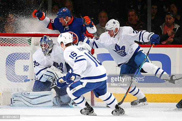 Jason Chimera of the New York Islanders collides with Jhonas Enroth of the Toronto Maple Leafs at the Barclays Center on October 30 2016 in Brooklyn...