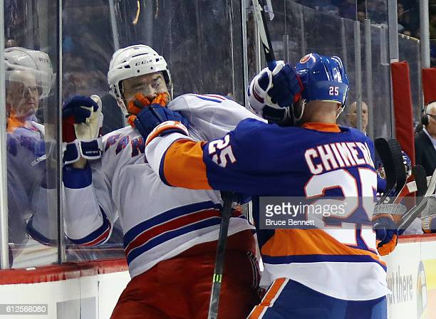 294a4714e ... Jason Chimera of the New York Islanders gets the gloves up on Dylan  McIlrath of the Hockey ...