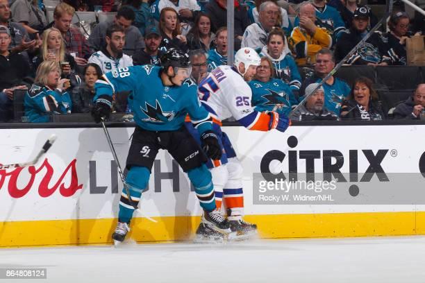 Jason Chimera of the New York Islanders skates against Timo Meier of the San Jose Sharks at SAP Center on October 14 2017 in San Jose California