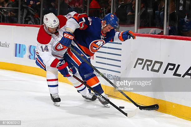 Jason Chimera of the New York Islanders skates against Tomas Plekanec of the Montreal Canadiens at the Barclays Center on October 26 2016 in Brooklyn...