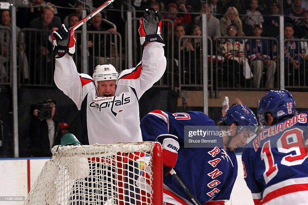 <a gi-track='captionPersonalityLinkClicked' href=/galleries/search?phrase=Jason+Chimera&family=editorial&specificpeople=211264 ng-click='$event.stopPropagation()'>Jason Chimera</a> #25 of the Washington Capitals celebrates after he scored a first period goal against the New York Rangers in Game Two of the Eastern Conference Semifinals during the 2012 NHL Stanley Cup Playoffs at Madison Square Garden on April 30, 2012 in New York City.