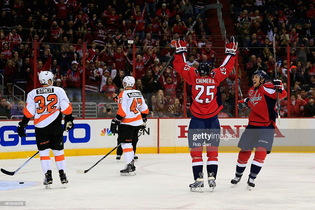 <a gi-track='captionPersonalityLinkClicked' href=/galleries/search?phrase=Jason+Chimera&family=editorial&specificpeople=211264 ng-click='$event.stopPropagation()'>Jason Chimera</a> #25 of the Washington Capitals celebrates his first period goal with teammate <a gi-track='captionPersonalityLinkClicked' href=/galleries/search?phrase=Jay+Beagle&family=editorial&specificpeople=4671535 ng-click='$event.stopPropagation()'>Jay Beagle</a> #83 against the Philadelphia Flyers at Verizon Center on January 14, 2015 in Washington, DC.