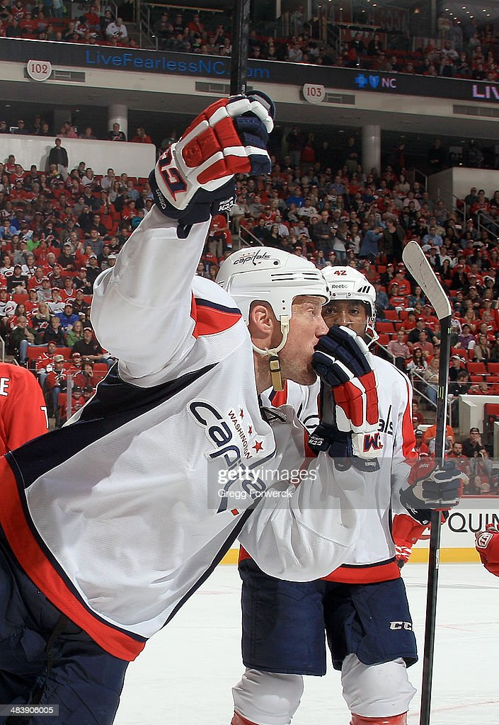 <a gi-track='captionPersonalityLinkClicked' href=/galleries/search?phrase=Jason+Chimera&family=editorial&specificpeople=211264 ng-click='$event.stopPropagation()'>Jason Chimera</a> #25 of the Washington Capitals celebrates his second-period goal against the Carolina Hurricanes during their NHL game at PNC Arena on April 10, 2014 in Raleigh, North Carolina.