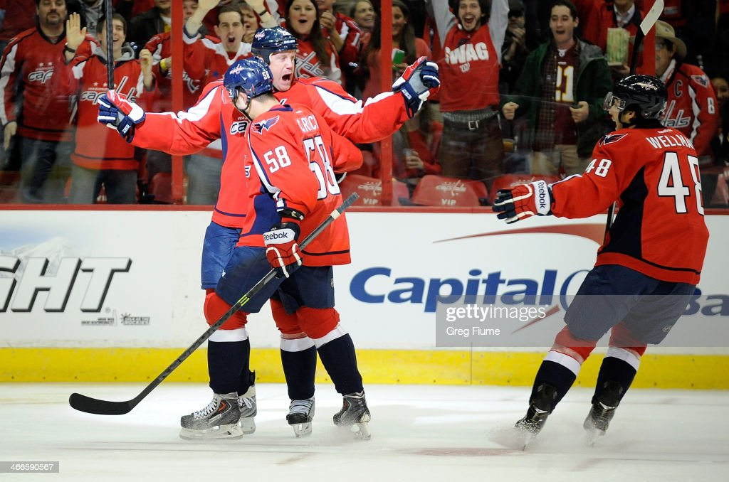 <a gi-track='captionPersonalityLinkClicked' href=/galleries/search?phrase=Jason+Chimera&family=editorial&specificpeople=211264 ng-click='$event.stopPropagation()'>Jason Chimera</a> #25 of the Washington Capitals celebrates with <a gi-track='captionPersonalityLinkClicked' href=/galleries/search?phrase=Connor+Carrick&family=editorial&specificpeople=9491429 ng-click='$event.stopPropagation()'>Connor Carrick</a> #58 and Casey Wellman #48 after scoring in the first period against the Detroit Red Wings at Verizon Center on February 2, 2014 in Washington, DC.