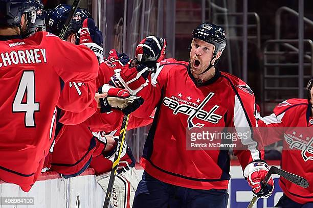 Jason Chimera of the Washington Capitals celebrates with his teammates after scoring a goal against the Tampa Bay Lightning in the second period...