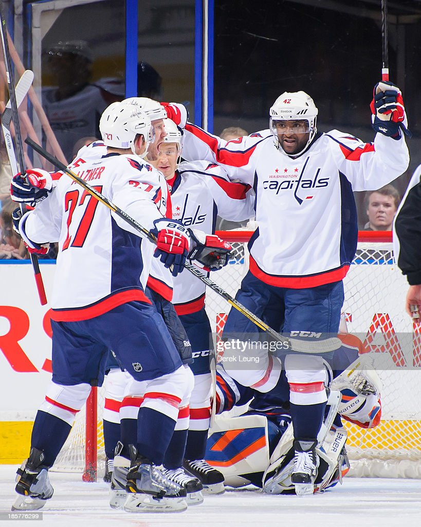 <a gi-track='captionPersonalityLinkClicked' href=/galleries/search?phrase=Jason+Chimera&family=editorial&specificpeople=211264 ng-click='$event.stopPropagation()'>Jason Chimera</a> #25 of the Washington Capitals celebrates with teammates <a gi-track='captionPersonalityLinkClicked' href=/galleries/search?phrase=Karl+Alzner&family=editorial&specificpeople=3938829 ng-click='$event.stopPropagation()'>Karl Alzner</a> #27 and Joel Ward #42 after scoring the team's second goal against the Edmonton Oilers at Rexall Place on October 24, 2013 in Edmonton, Alberta, Canada.