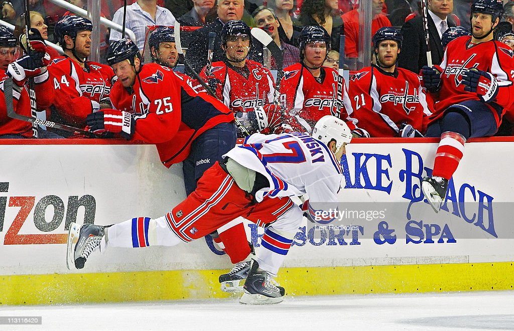 <a gi-track='captionPersonalityLinkClicked' href=/galleries/search?phrase=Jason+Chimera&family=editorial&specificpeople=211264 ng-click='$event.stopPropagation()'>Jason Chimera</a> #25 of the Washington Capitals checks <a gi-track='captionPersonalityLinkClicked' href=/galleries/search?phrase=Brandon+Dubinsky&family=editorial&specificpeople=2271907 ng-click='$event.stopPropagation()'>Brandon Dubinsky</a> #17 of the New York Rangers in Game Five of the Eastern Conference Quarterfinals during the 2011 NHL Stanley Cup Playoffs at the Verizon Center on April 23, 2011 in Washington, DC.
