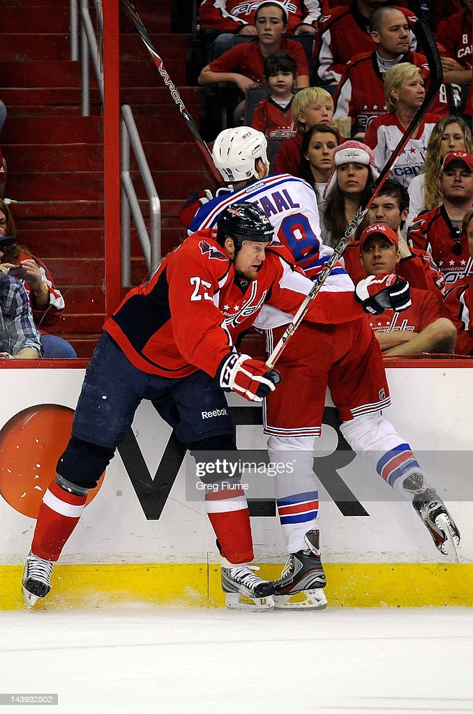 <a gi-track='captionPersonalityLinkClicked' href=/galleries/search?phrase=Jason+Chimera&family=editorial&specificpeople=211264 ng-click='$event.stopPropagation()'>Jason Chimera</a> #25 of the Washington Capitals checks <a gi-track='captionPersonalityLinkClicked' href=/galleries/search?phrase=Marc+Staal&family=editorial&specificpeople=3809026 ng-click='$event.stopPropagation()'>Marc Staal</a> #18 of the New York Rangers in Game Four of the Eastern Conference Semifinals during the 2012 NHL Stanley Cup Playoffs at the Verizon Center on May 5, 2012 in Washington, DC.