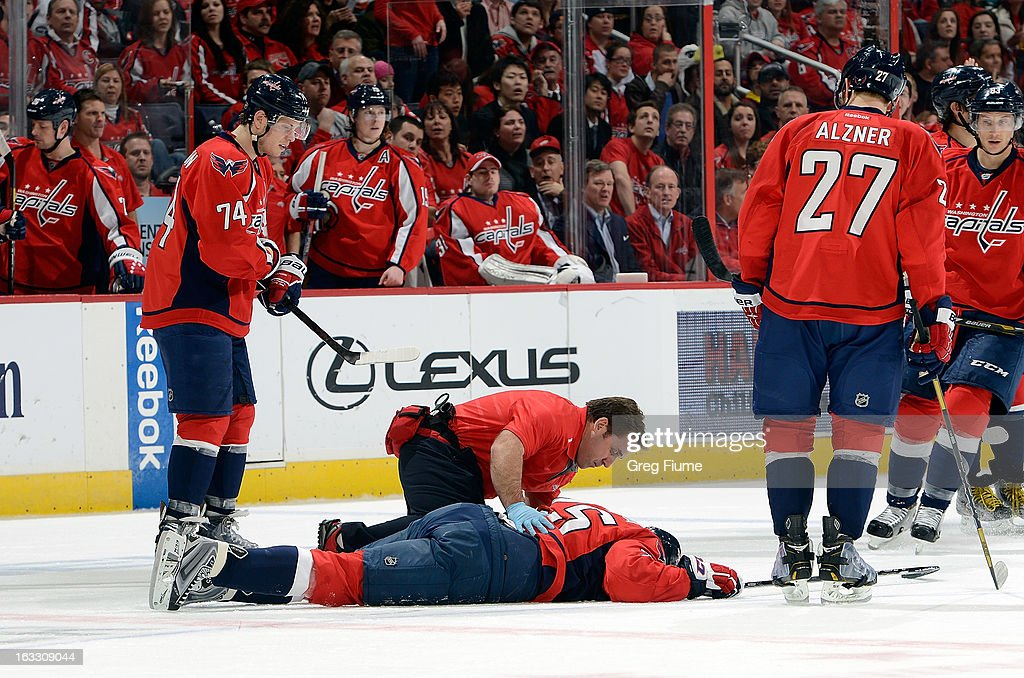 <a gi-track='captionPersonalityLinkClicked' href=/galleries/search?phrase=Jason+Chimera&family=editorial&specificpeople=211264 ng-click='$event.stopPropagation()'>Jason Chimera</a> #25 of the Washington Capitals is attended to by head athletic trainer Greg Smith after being hit by Tyson Strachan #23 (not pictured) of the Florida Panthers at the Verizon Center on March 7, 2013 in Washington, DC.